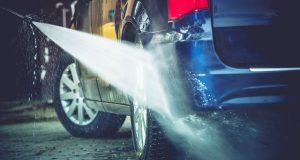 Man washing car with Best Pressure Washer