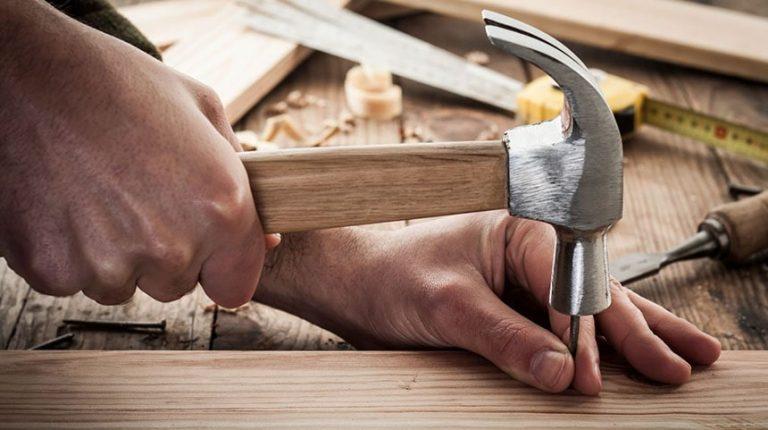 A man is using Best Hammer in Australia